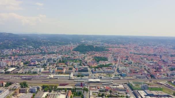 Graz, Austria. The historic city center aerial view. Mount Schlossberg (Castle Hill). 4K