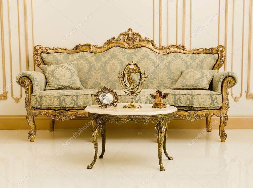 Baroque Gold Mirrors Baroque gold sofa, table and mirrors in a luxurious roomu2013 stock image