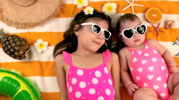 children sisters sunbathe on the beach. selective focus.