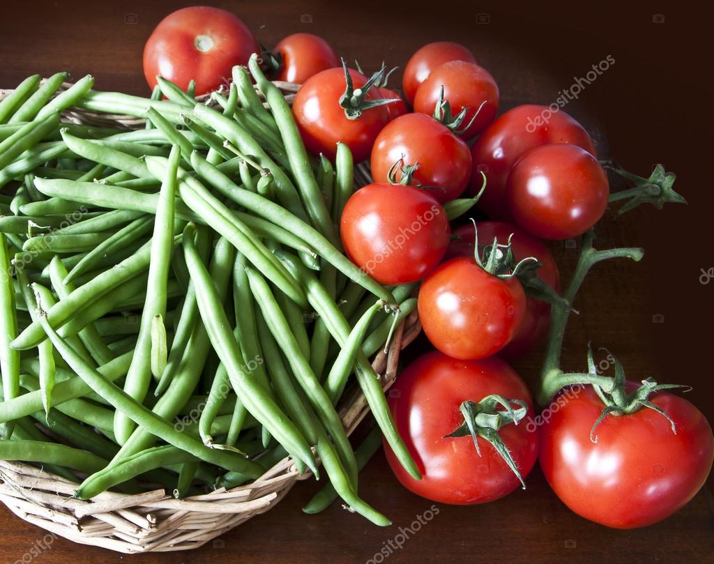 Raw vegetables harvest, green beans and tomatoes