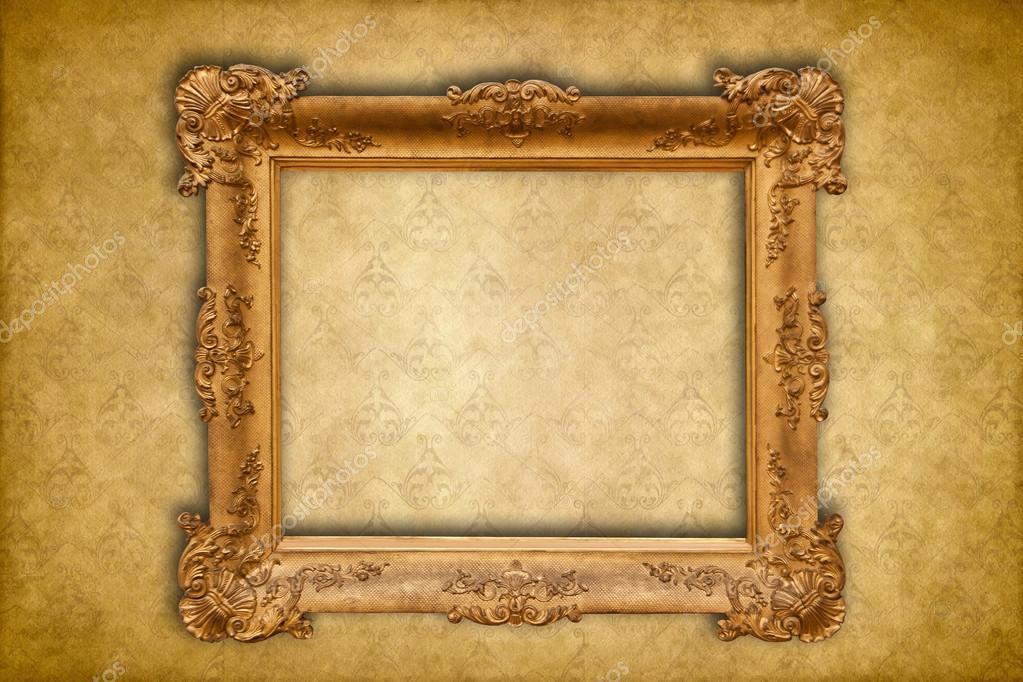 gold baroque frame on a golden damask victorian wallpaper stock