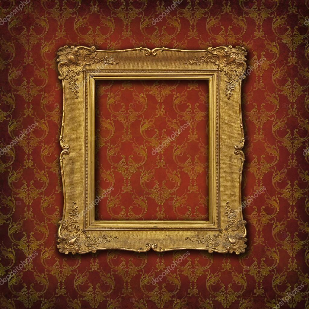 gold baroque frame on a red damask victorian wallpaper stock photo