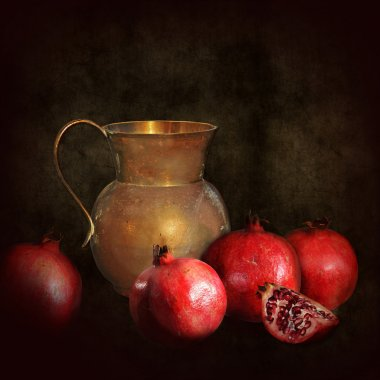 Retro still life, old brass jug with pomegranate