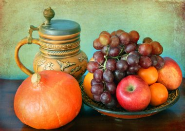 Still life: seasonal fruits and hokkaido pumpkin and a mug