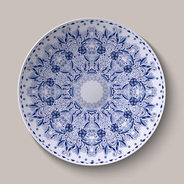 Round blue lacy delicate floral pattern. Stylized Chinese style painting on porcelain.