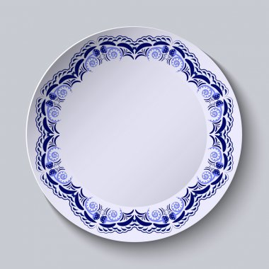 Blue floral pattern on the rim of the plate. Imitation of Chinese porcelain painting.