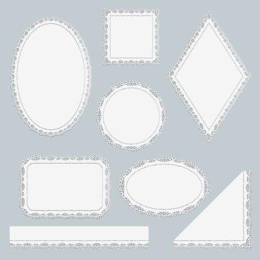 Set of white lace elements isolated on gray background.