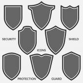 Fotografie Set of shield icons. Monochrome security signs isolated on white background.