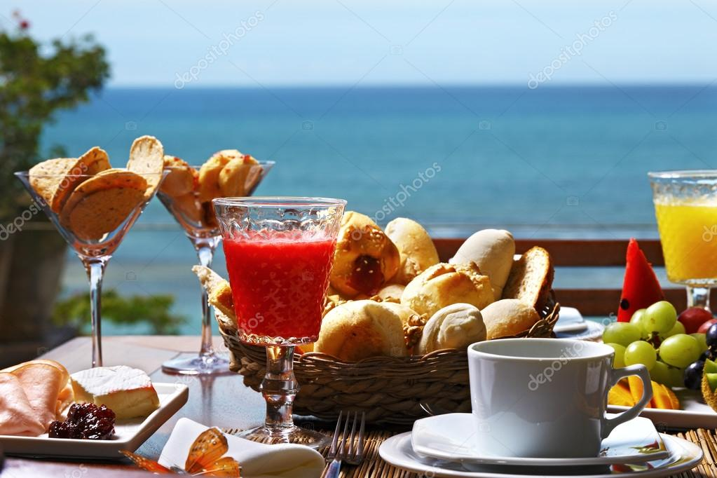 Breakfast  with fruits, buns and  juices