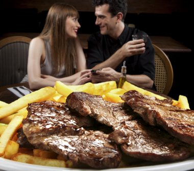 Couple in restaurant tasted roast beef