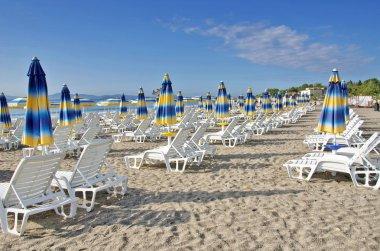 Beach chairs and umbrellas on the beach the Black Sea, Bulgaria stock vector