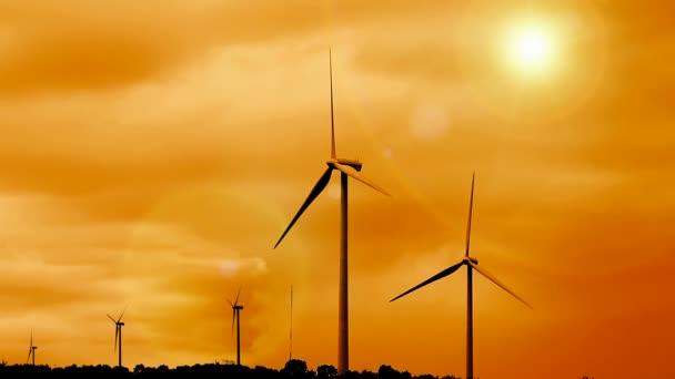 východ slunce a obnovitelné zdroje větrné farmy
