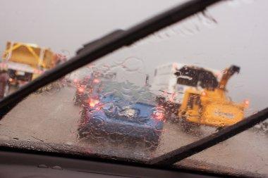 POV Windshield Wipers Displacing Heavy Rain In Rush Hour Traffic
