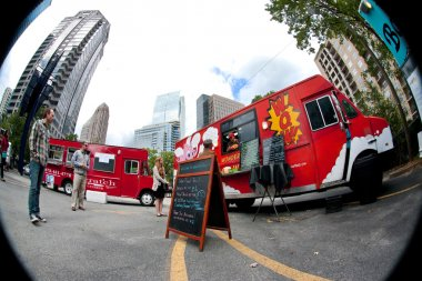 Fish Eye Perspective Of Customers Buying Meals From Food Trucks