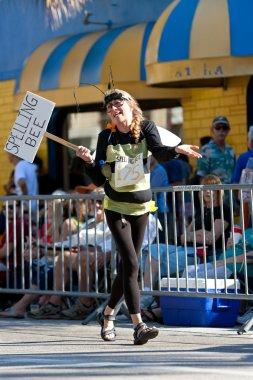Woman Wears Spelling Bee Costume In Miami's Mango Strut Parade