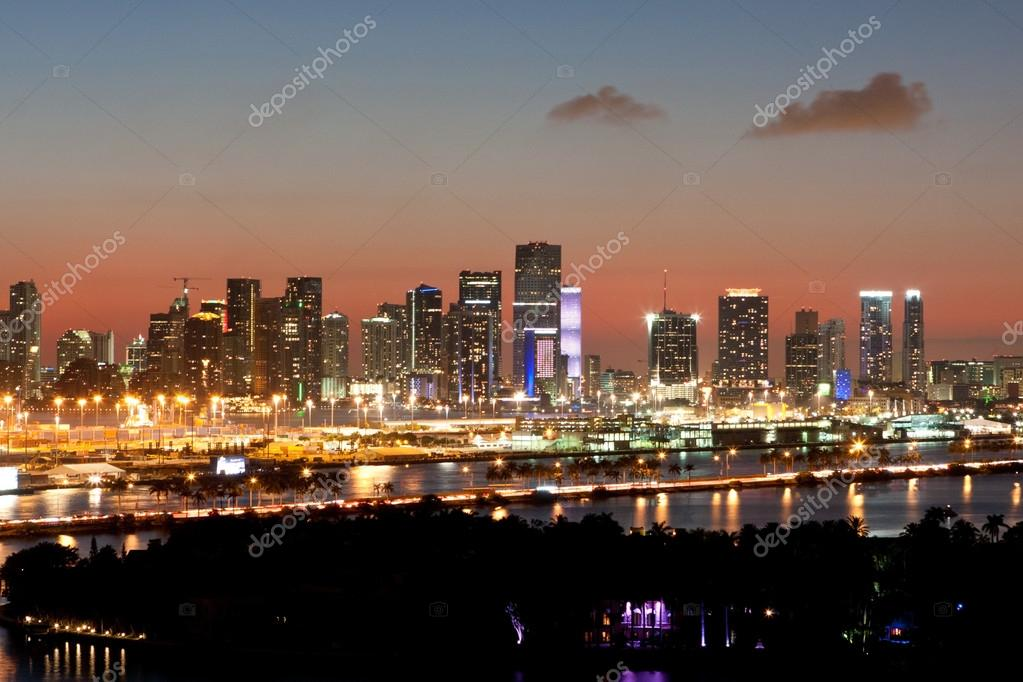 Miami Skyline Lights Up At Dusk Against Pink Sunset Stock Photo
