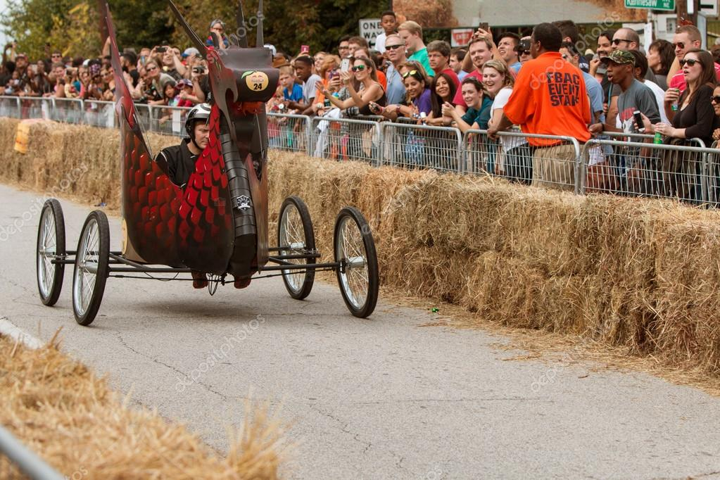 Red Bull Soap Box Derby >> Man Steers Dragon Vehicle Down Street In Soap Box Derby