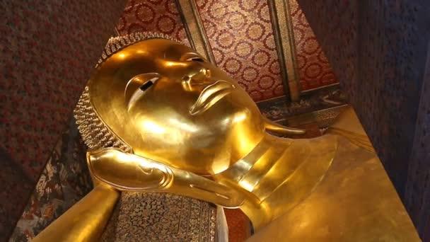 Beautiful Gold Image Buddha Posture Sleep Of Wat Pho Temple Bangkok, Thailand (zoom out)