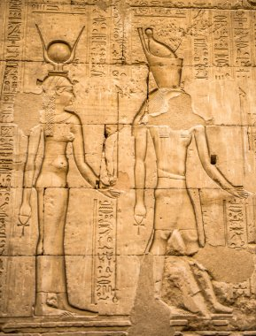Egyptian hieroglyphs on the wall in a temple