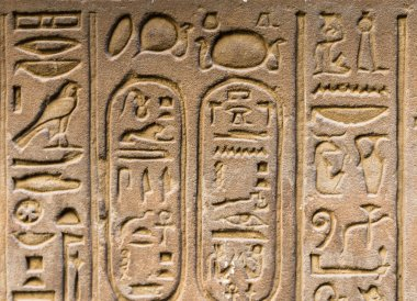 Egyptian hieroglyphs on the wall in the Sobek temple in Kom Ombo, Egypt