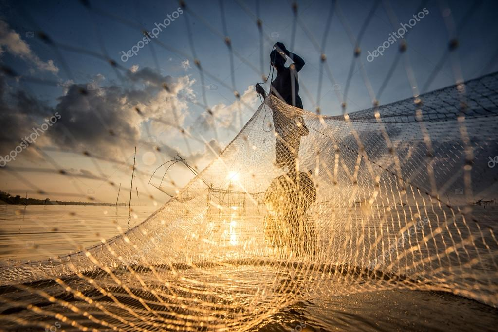 Landscape of Pakpra with fisherman in sunrise at Phatthalung, Th