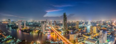 Bangkok Transportation at Dusk with Modern Business Building alo