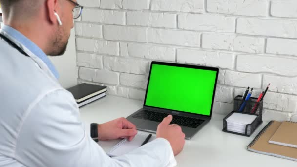 Doctor looking green screen laptop consult talk patient offers treatment options