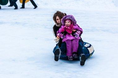 Baby winter sledding on the Ural River