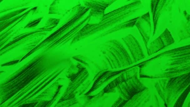 Malování barvou zelenou vodu na sklo