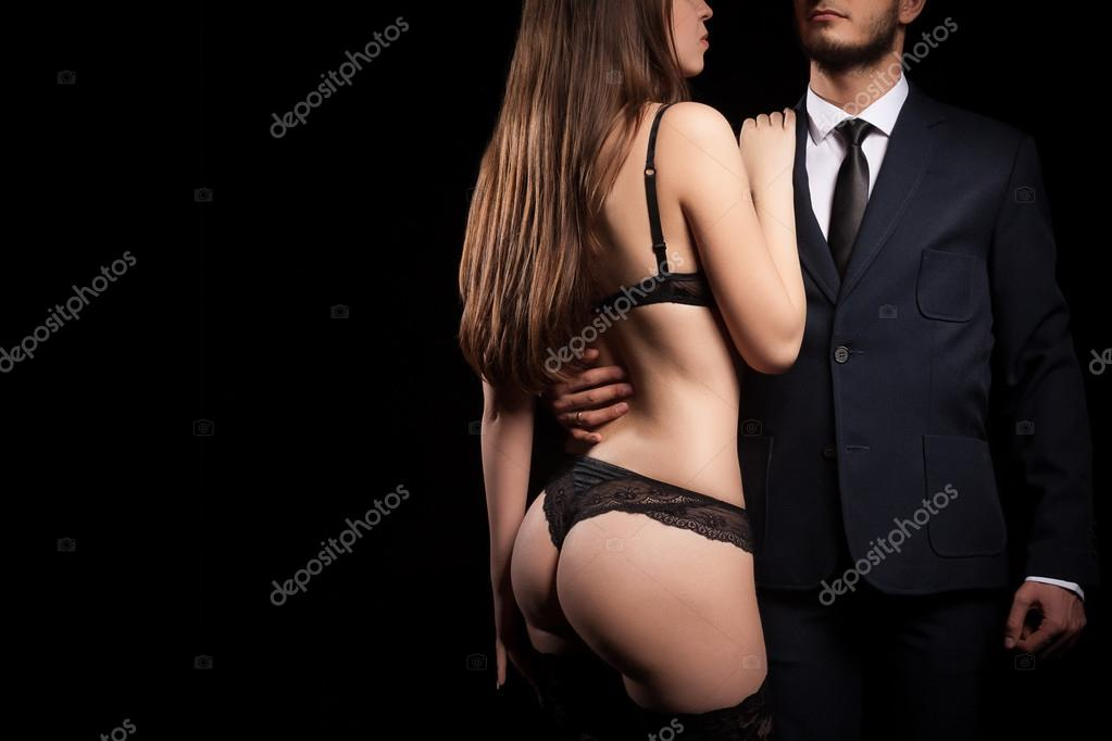 Meleg férfi bondage rabszolga. Öltöny, nyakkendő rabságból.