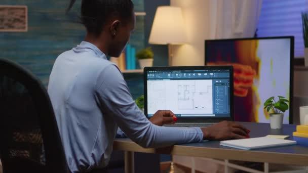 Black employee checking digital blue prints analysing project