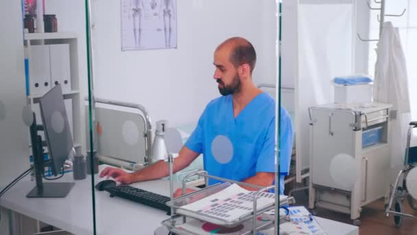 Medical man nurse writing on pc list of patient and health report