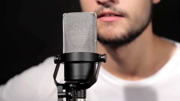 Singing at microphone in music studio