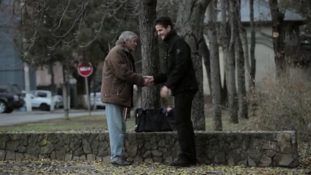 Young men helping an older man