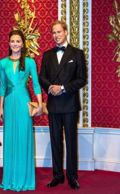 Wax figures of Prince William and Kate Middleton are seen on display at Madame Tussauds museum. London. UK