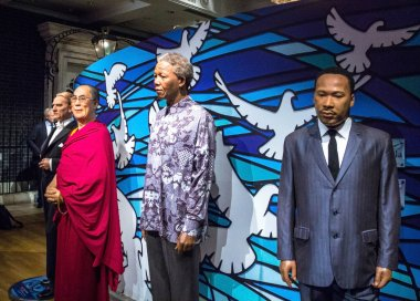 Wax figures of Nelson Mandela, Dalai Lama ,  Martin Luther King, Jr. in  Madame Tussauds museum in London.