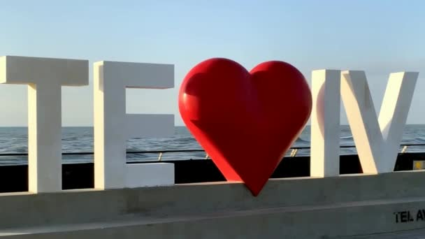 Tel Aviv, Israel - March 3, 2019: Tel Aviv love sign at the City old port on blue sky and Mediterranean Sea background