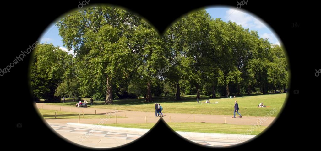 Covert surveillance of the suspects in the park with binoculars