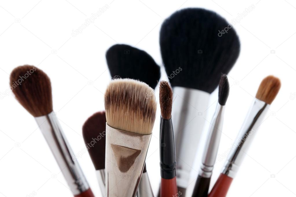 Makeup Brushes And Cosmetic Powder Stock Photo