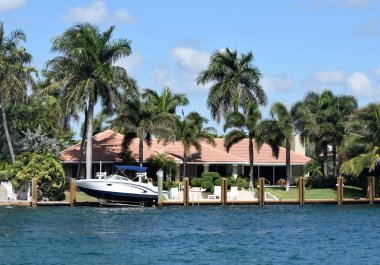 Waterfront mansion with boat and dock