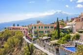 Photo Taormina with Etna volcano in Italy