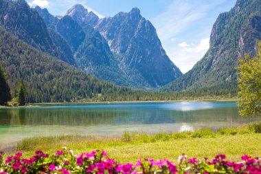 Lake Dobbiaco in Dolomites mountains