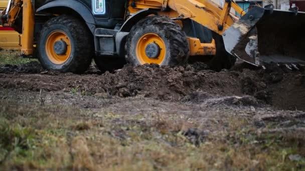 Rypadlo nakladač na silniční stavební práce
