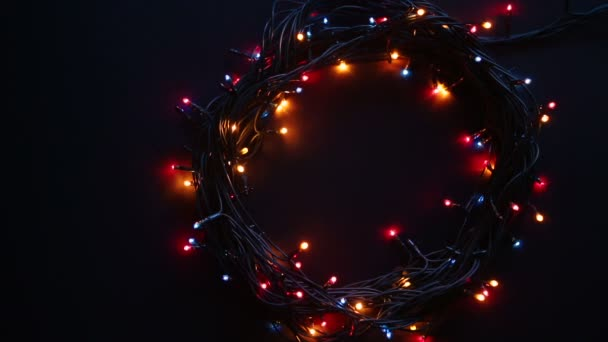 Christmas lamp garland motion on a black background