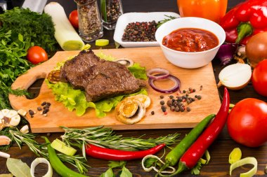 Beef on Wood Cutting Board with Salsa and Veggies