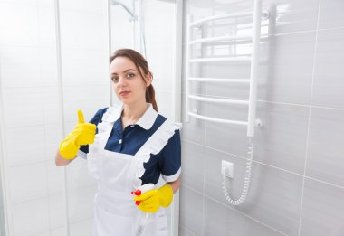 Domestic worker with thumbs and spray bottle