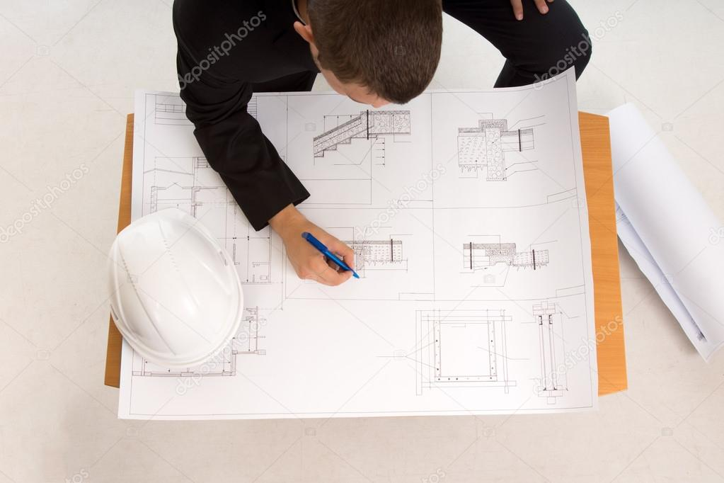 Architect drafting a building plan