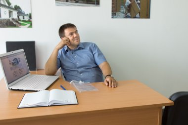 Male Entrepreneur at His Desk Thinking