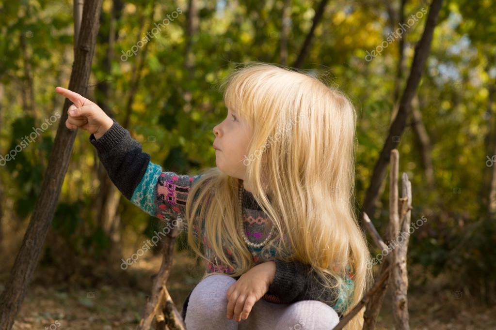 Little blond girl pointing to the side