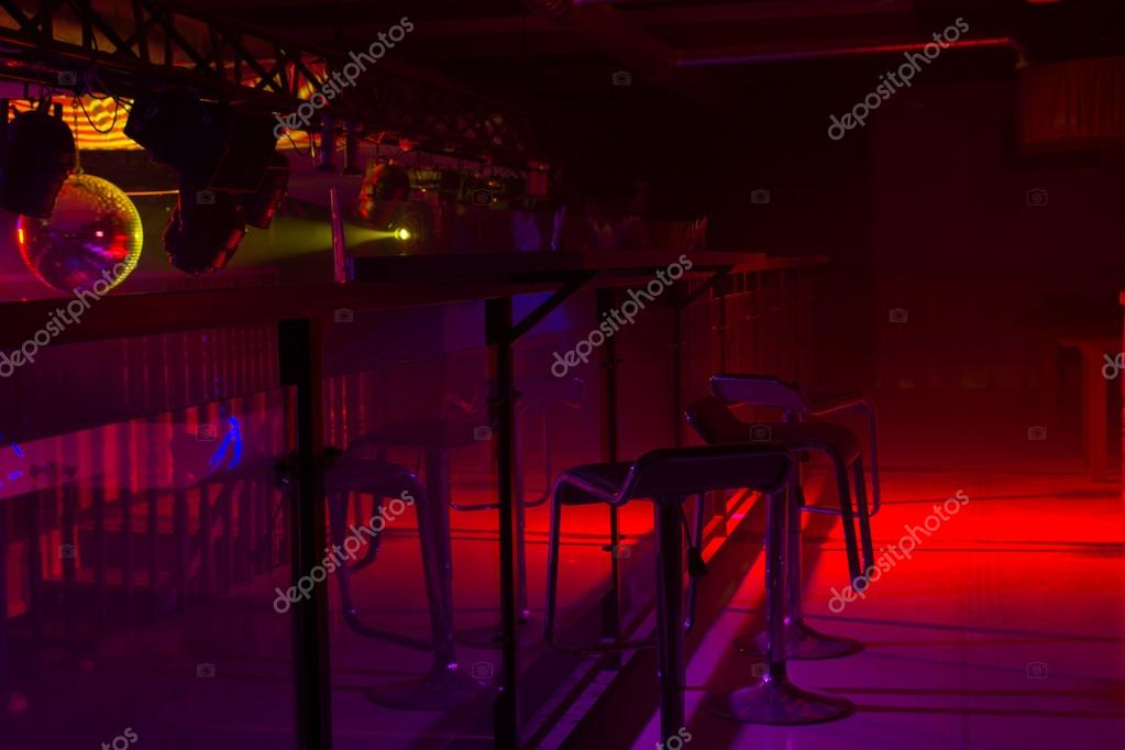 Modern Bar Interior Decor And Colorful Red And Purple Strobe Lighting  Illuminating A Row Of Stylish Bar Stools At A Counter U2014 Fotografia Por  Vaicheslav